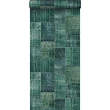 carta da parati tappeto kilim patchwork orientale in stilo Ibiza e Marrakech verde smeraldo intenso
